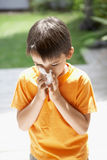 Boy Blowing Nose Royalty Free Stock Photography