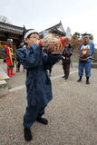 Boy is blowing a snail-trumpet. KAGAWA, JAPAN - NOVEMBER 20: boy is blowing a snail-trumpet of the start of the war at Marugame-castle Festival on November 20 Royalty Free Stock Image