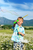 Boy blowing soap bubbles Stock Photo
