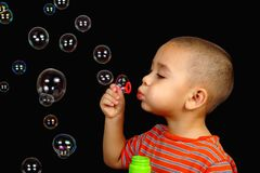 Boy blowing soap bubbles. Horizontal portrait of a child playing with bubbles Stock Images