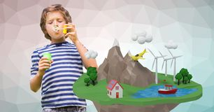 Boy blowing soap bubbles by low poly earth Stock Photography