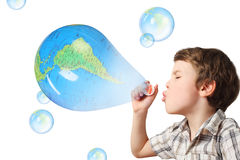 Boy blowing soap bubbles on white Royalty Free Stock Photography