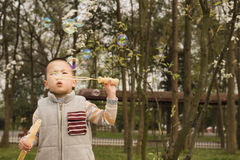 Boy blowing soapbubbles Stock Photography