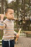 Boy blowing soapbubbles Stock Photo