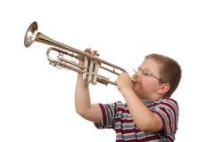 Boy Blowing Trumpet Royalty Free Stock Photos