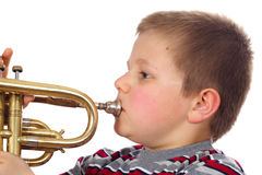 Boy Blowing Trumpet Royalty Free Stock Photo
