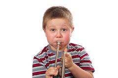 Boy Blowing Trumpet Royalty Free Stock Photography