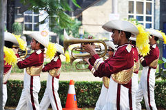 Boy blowing trumpet in marching band festival Royalty Free Stock Photography