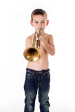 Boy blowing into a trumpet Stock Images