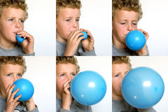 Boy blowing up Balloon Royalty Free Stock Photos