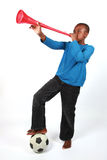 Boy Blowing Vuvuzela. Boy Blowing a red Vuvuzela stock photos