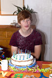 Boy blows out his birhday candles Royalty Free Stock Photo