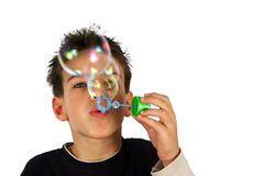 Boy blows up balloon. Young boy blows up balloon, isolated on white background Royalty Free Stock Photos