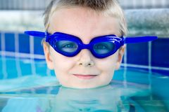 Boy in the blue. Young boy wearing diving mask or goggles in the swimming pool afternoon Stock Photos