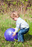 Boy with blue ball Stock Image