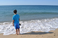 Boy at the Blue Beach Royalty Free Stock Photo
