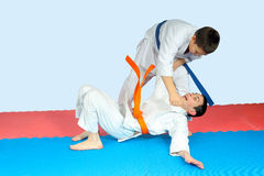 Boy with blue belt is the throwing athlete with an orange belt Royalty Free Stock Photos
