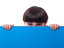Boy and blue board Stock Photo