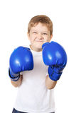 Boy in blue boxing gloves, isolated on white background. Stock Photo