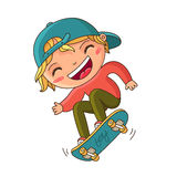 Boy in a blue cap doing a trick on a skateboard Stock Image