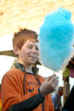 Boy with blue cotton candy Royalty Free Stock Photos