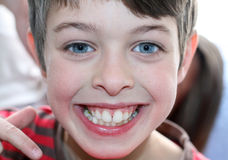 Boy with blue eyes is smiling. Happy boy is smiling and showing his teeth Stock Photography