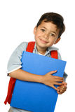 Boy with blue folder. Beautiful boy with red school rucksack and blue folder ready to go to school, isolated royalty free stock image