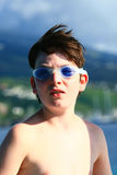 Boy in blue goggles Stock Image