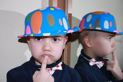 Boy with blue hat. Is thinking how to go to fairy tale Stock Image