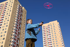 Boy in blue jacket plays with propeller Stock Photos