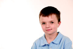 Boy in blue shirt Stock Photos
