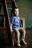 The boy in the blue shirt and corduroy pants Stock Photos