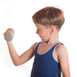 Boy blue shirt doing exercises with dumbbells over white backgro Stock Image
