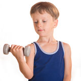 Boy blue shirt doing exercises with dumbbells over white backgro Royalty Free Stock Images