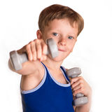 Boy blue shirt doing exercises with dumbbells over white backgro Stock Photography