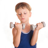 Boy blue shirt doing exercises with dumbbells over white backgro Stock Images