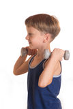 Boy blue shirt doing exercises with dumbbells over white backgro Stock Photos