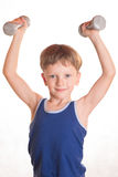 Boy blue shirt doing exercises with dumbbells over white backgro Royalty Free Stock Photography