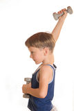 Boy blue shirt doing exercises with dumbbells over white backgro Royalty Free Stock Photo