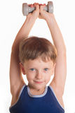 Boy blue shirt doing exercises with dumbbells over white backgro Royalty Free Stock Photos