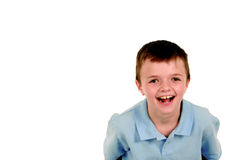 Boy in blue shirt laughing Royalty Free Stock Photo