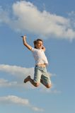Boy on blue sky background Stock Images
