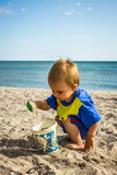 A boy in a blue suit played on the beach Stock Photography