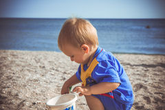 A boy in a blue suit played on the beach Royalty Free Stock Photo