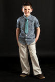 Boy In Blue Tie Snickering Royalty Free Stock Images