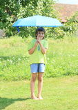 Boy with blue umbrella Royalty Free Stock Photography