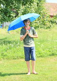 Boy with blue umbrella Royalty Free Stock Photos