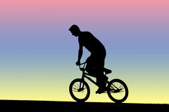 Boy in BMX Bicycle. Silhouette Stock Photo