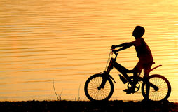Boy on BMX silhouette background Royalty Free Stock Photo