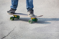 Boy on the board going оп to asphalt Royalty Free Stock Images